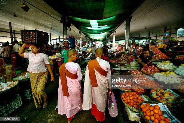 TWo nuns walk in the Yangon vegetables and fruits wholesale market