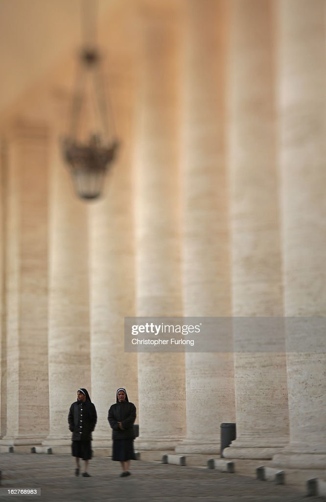 Two nuns walk through The Colonnade of St Peter's Square on February 26, 2013 in Vatican City, Vatican. The Pontiff will hold his last weekly public audience on February 27, 2013 before he retires the following day. Pope Benedict XVI has been the leader of the Catholic Church for eight years and is the first Pope to retire since 1415. He cites ailing health as his reason for retirement and will spend the rest of his life in solitude away from public engagements.