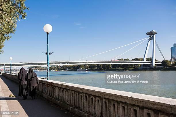 Two nuns walking by the river Danube, Bratislava, Slovakia