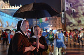 Two Nuns watche a concert in Krakow's Main Square due to the rain On Tuesday 26 July 2016 in Krakow Poland