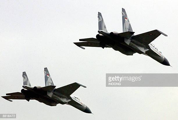 Two of four Russian Sukhoi belonging to the Indonesian Air Force fly in formation during 58th anniversary of the air force in Jakarta 10 April 2004...