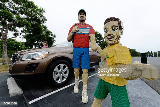 Two of hundreds of Lego figures is seen next to Volvo designated parking spot at North America's first ever Legoland Hotel at Legoland on September...