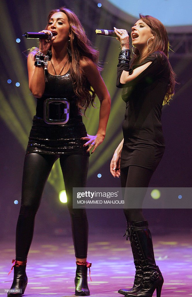 Two of Lebanon's 'Four Cats' pop music band peform at the Muscat festival 24 January 2008 in the Omani capital. The annual cultural festival started on January 21 and will continue with Arab and international events until February 15.