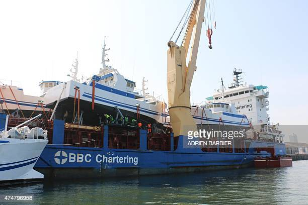 Two of six french built fishing vessels dock at the Maputo Harbour on May 26 2015 in Maputo part of the latest batch of fishing vessels built at...