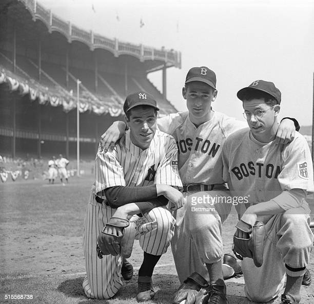 Two of the brothers DiMaggio Joe left of the New York Yankees and Dominik right of the Boston Red Sox get together with Boston's star outfielder Ted...