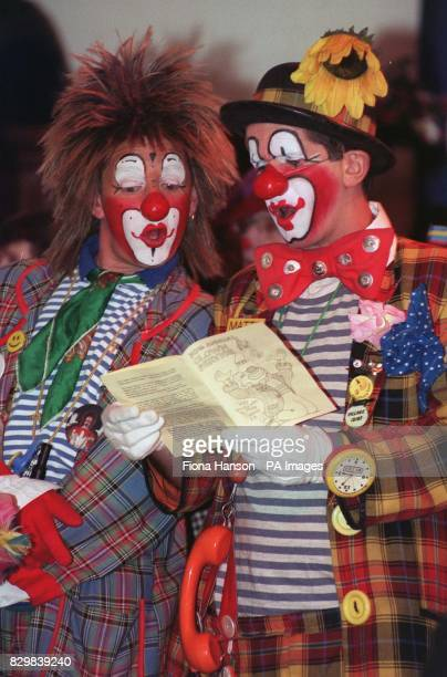 Two of the congregation join in the hymn singing at the 50th annual clown service The service is held every year at the Clown's Church Holy Trinity...