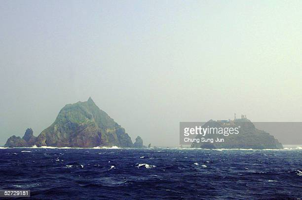 Two of the Dokdo Islets known by the Japanese as the Takeshima Islands are seen from a South Korean coast guard ship as it sails close to the...