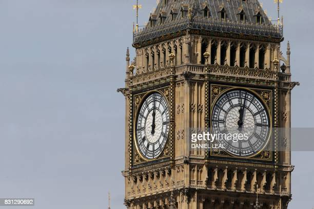 Two of the four faces of the Great Clock of the Elizabeth Tower commonly referred to as Big Ben are pictured at the Houses of Parliament in central...