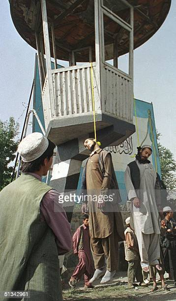 Two of the four men executed by Taliban Islamic militia are left hanging in a makeshift gallows in Kabul 08 August 2001 Taliban chief Mullah Mohammad...