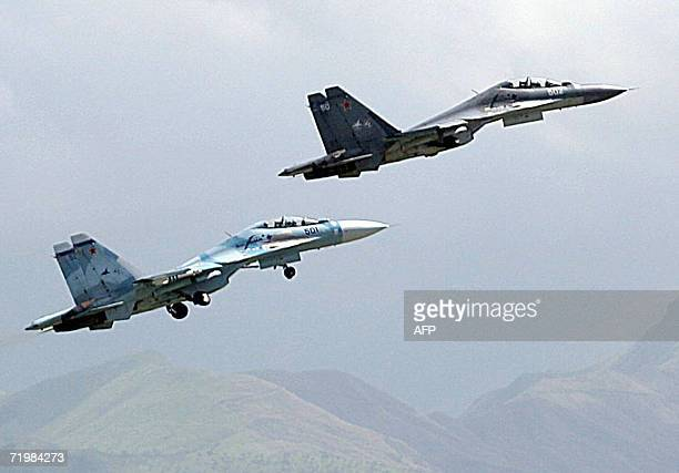 Two of the recently acquired Sukhoi30MX Russianmade fighters maneuver over a military base in the Venezuelan state of Aragua 110 km west of Caracas...
