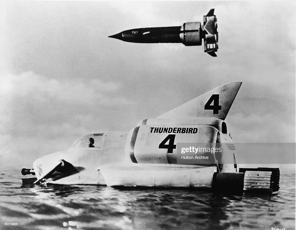 Two of the Thunderbird craft operated by International Rescue in a still from Gerry Anderson's science fiction marionette television series, 'Thunderbirds,' circa 1965. In the foreground is the utility submarine Thunderbird 4, and in the air is the hypersonic rocket plane Thunderbird 1.
