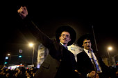 Two of the ultra orthodox Jewish seminary students who were released from prison dance during a demonstration on February 16 2015 in Jerusalem Israel...
