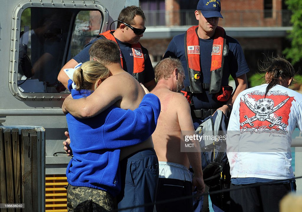 Two of the victims of a dive boat that capsized hug as they reunite at the Hillsboro Inlet Marina in Pompano Beach, Florida, Thursday, November 22, 2012. Four people were transported to an area hospital, one in critical condition. A commercial dive boat was hit by a massive wave and capsized just outside Hillsboro Inlet, officials said.
