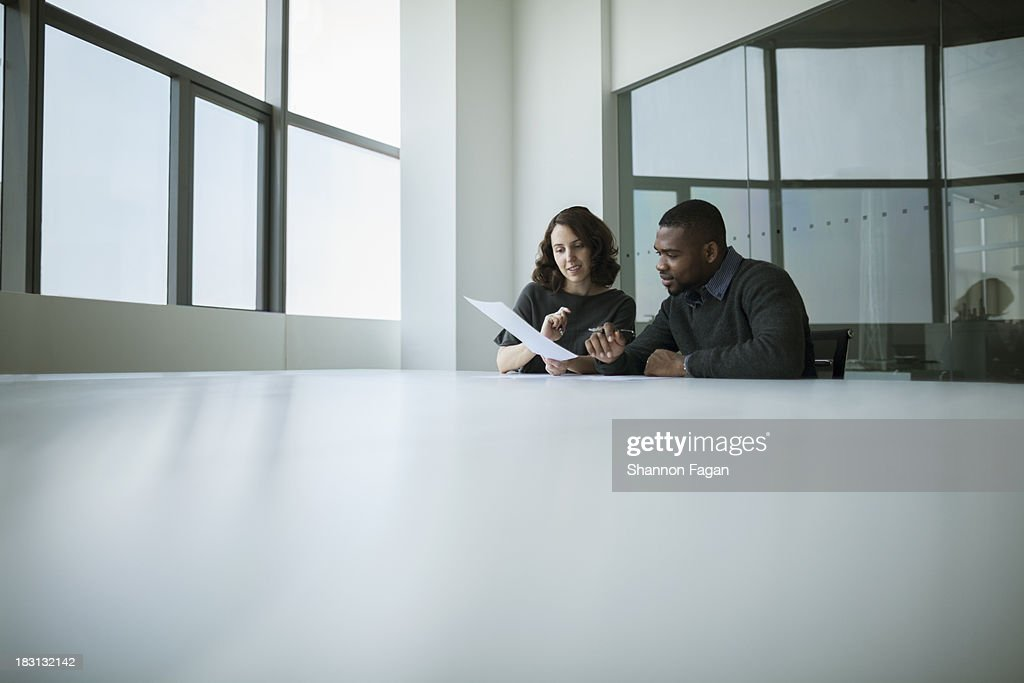 Two office coworkers working a project together : Stock Photo