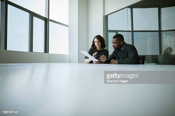 Two office coworkers working a project together