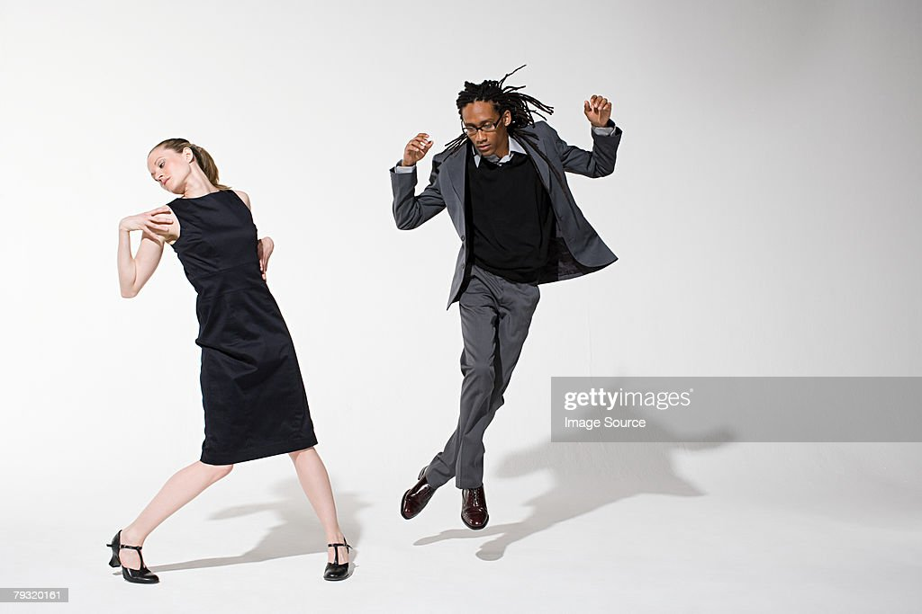 Two office workers dancing : Stock Photo
