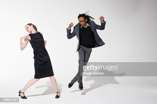 Two office workers dancing : ストックフォト
