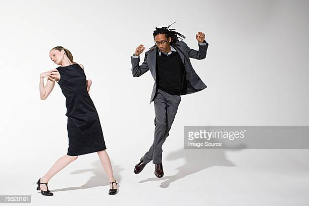Two office workers dancing