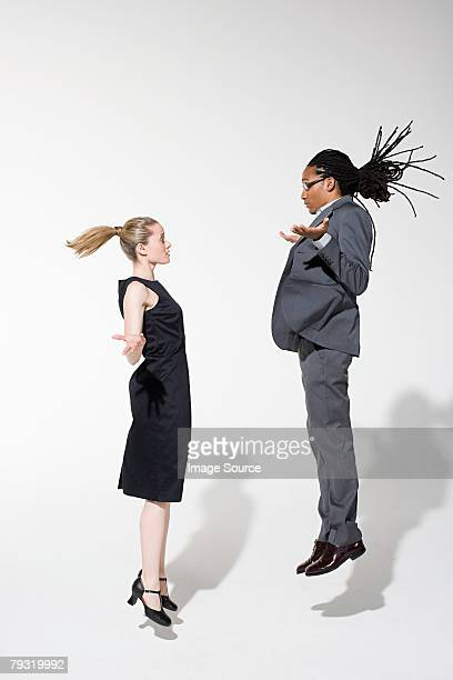Two office workers jumping