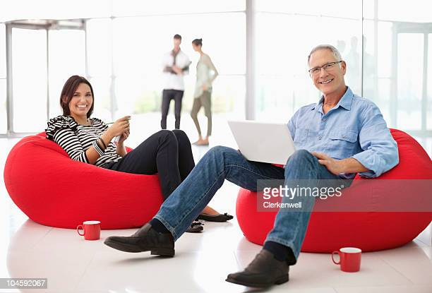 Two office workers on beanbags