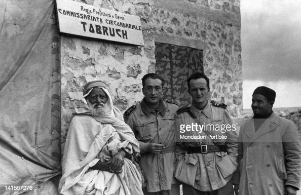 Two officers of the Prison Commissioner of the Italian army with two Libyan civiliansáTobruk June 1942