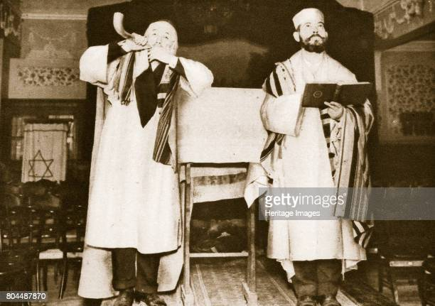 Two officials of an East End synagogue London 20th century One is blowing on a horn to symbolise the summoning together of all the scattered Jews for...