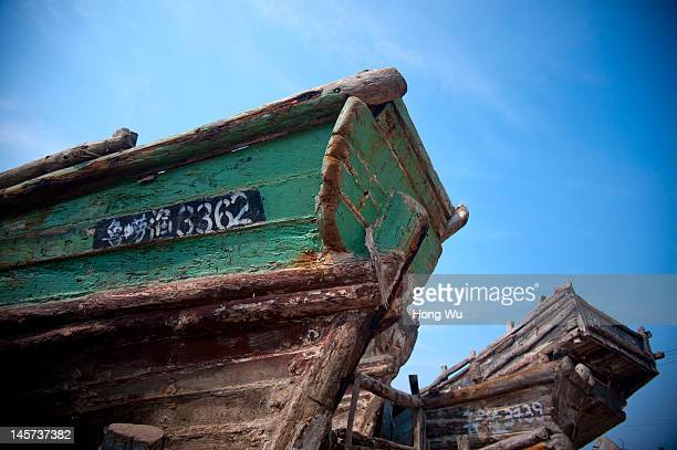 Two old fishing boats on land are seen on May 21 2012 in Qingdao China Marine fishery resources in China becomes less and lees due to excessive...