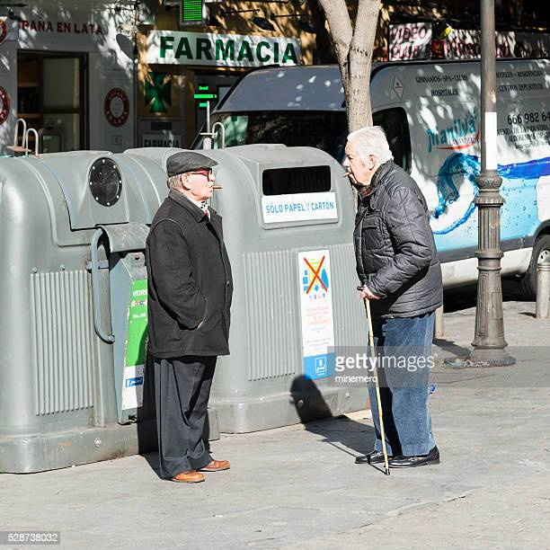 Two old friends standing on the street