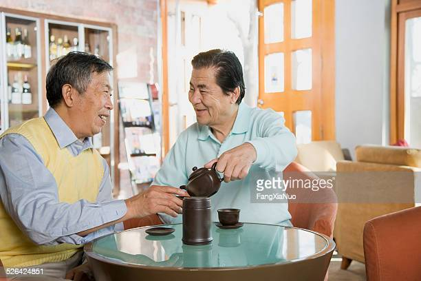 Two Old Men are Having Tea