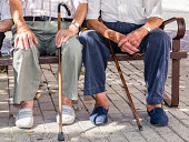 Two old men sitting on a park at summer