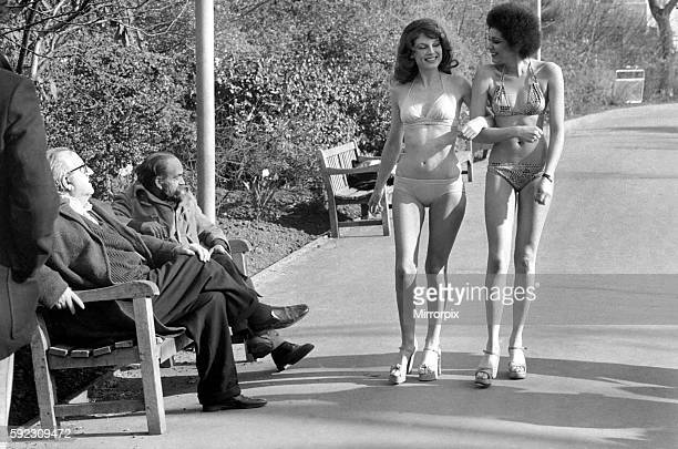 Two old men sitting on a park bench distracted by models in bikini February 1975 7501132011