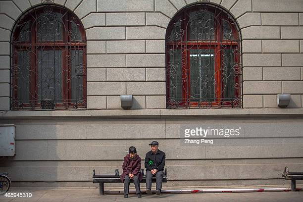 Two old people sits at roadside chatting China's pension fund faces great pressure to break even in coming years The government will gradually raise...