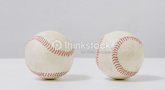 Two old white baseball