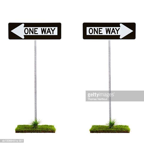 Two one way signs pointing to opposite directions