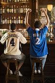 Two Opposing Soccer Fans in Bar