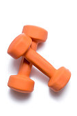Two orange dumbbells lie on top of each other on a white background.
