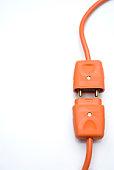 Two Orange Electric Plugs