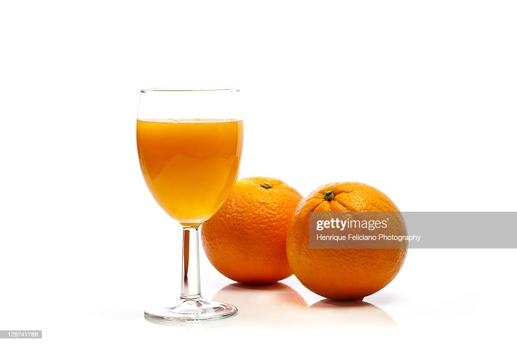 Two oranges and glass of orange juice : Stock Photo