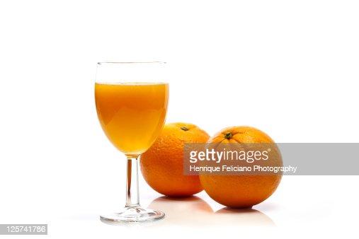 Two oranges and glass of orange juice : Stock Photo