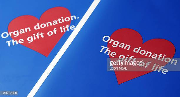 Two organ donor application leaflets are shown in London to illustrate the current moves by the British Government to propose a way to tackle the...