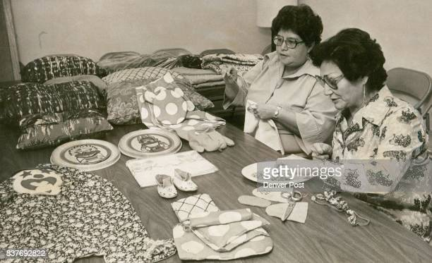Two outreach workers ply talents in conference room of center to help the Indians Vera Mitchell at left sews on quilt block and Suzanne Wilson...