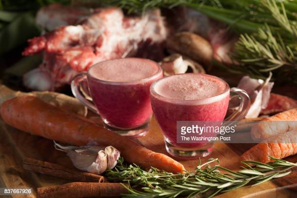 Two oz shots of 'the russian' broth drink pictured with various local ingredients used in the mire poix at Cauldron Broths in Bellingham Wash on Aug...