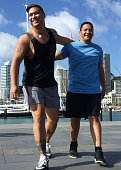 Two Pacific Islander men exercise outdoors in New Zealand