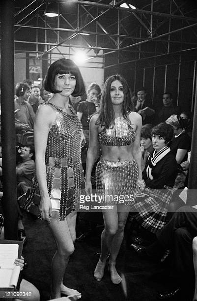 Two Paco Rabanne evening dresses constructed from hundreds of metal rings at a fashion show 1967