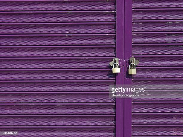 Two Padlocks on Purple Shutters