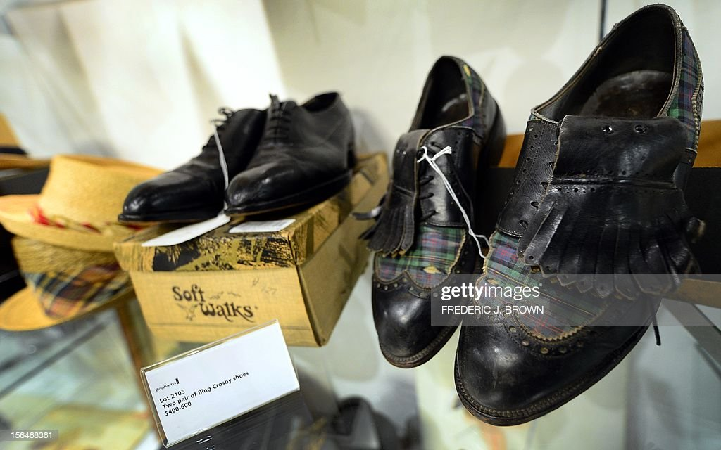 Two pairs of Bing Crosby's golf shoes, esitmated between $200 and $400, on display during a press preview at auction house Bonham's in Hollywood, California, on November 15, 2012, where Charlie Chaplin's iconic bowler hat and cane are to go under the hammer in this weekend as part of an auction which also includes the John Lennon nude drawing of himself and Yoko Ono, part of the Lennon lot estomated between $18,000 and $22,000 , among memorabilia from other artists. The hat and cane trademark of Chaplin's Little Tramp character are in 'remarkable condition' and are estimated to go for between $40,000 and $60,000 at the sale by auction house Bonhams on Sunday November 18. AFP PHOTO / Frederic J. BROWN