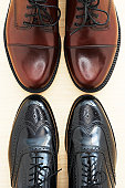 Two pairs of brogues, toe to toe, overhead view, close-up