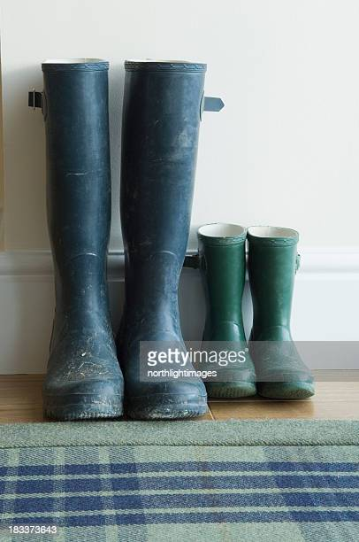 Two pairs of large and small wellington boots