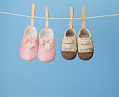 Two Pairs of Shoes on Clothes Line