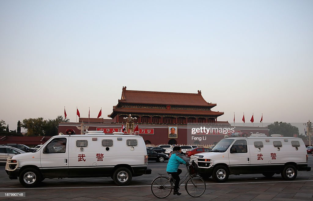 Two paramilitary police cars guard at the Tiananmen Square on November 14, 2013 in Beijing, China. The 18th Central Committee of the Communist Party of China (CPC) decides to set up a state security committee at the close of the Third Plenary Session of the 18th CPC Central Committee on Tuesday.